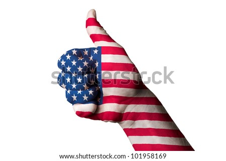 Hand with thumb up gesture in colored america national flag as symbol of excellence, achievement, good, - for tourism and touristic advertising, positive political, social management of country - stock photo