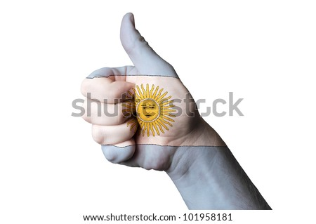 Hand with thumb up gesture in colored argentina national flag as symbol of excellence, achievement, good, - for tourism and touristic advertising, positive political, social management of country