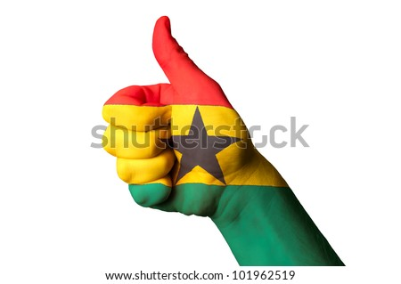 Hand with thumb up gesture in colored ghana national flag as symbol of excellence, achievement, good, - for tourism and touristic advertising, positive political, social management of country - stock photo