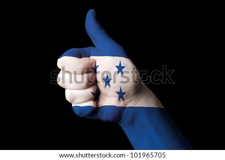 Hand with thumb up gesture in colored honduras national flag as symbol of excellence, achievement, good, - for tourism and touristic advertising, positive political, social management of country