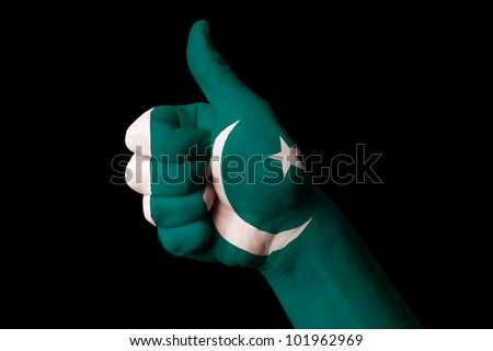 Hand with thumb up gesture in colored pakistan national flag as symbol of excellence, achievement, good, - for tourism and touristic advertising, positive political, social management of country - stock photo