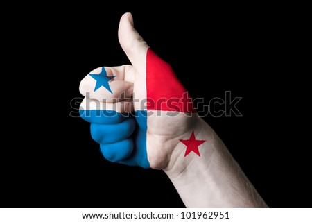 Hand with thumb up gesture in colored panama national flag as symbol