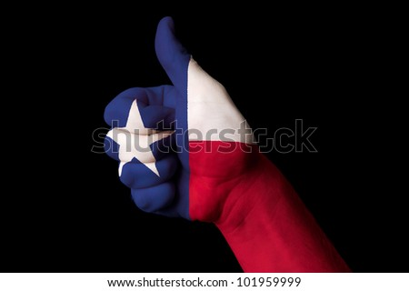 Hand with thumb up gesture in colored texas usa state flag as symbol of excellence, achievement, good, - for tourism and touristic advertising, positive political, social management of country - stock photo
