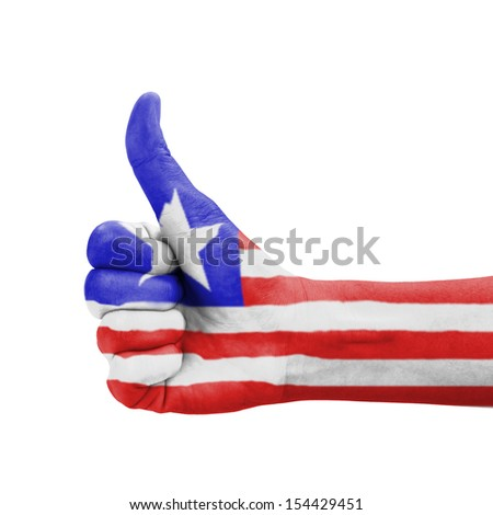 Hand with thumb up, Liberia flag painted as symbol of excellence, achievement, good - isolated on white background