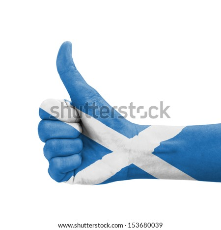 Hand with thumb up, Scotland flag painted as symbol of excellence, achievement, good - isolated on white background
