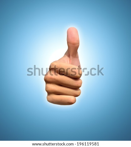 Hand with thumb up, view from the front. Isolated on blue background - stock photo
