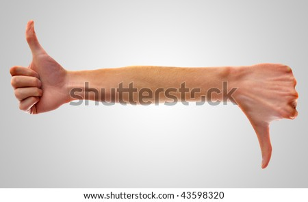 Hand with thumbs up on left side, and with thumbs down on right side. This demonstrates controversies and disagreements. - stock photo