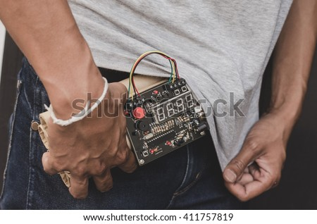 hand with time bomb. hands strapped with bomb. time bomb - stock photo
