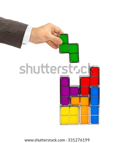 Hand with toy blocks isolated on white background - stock photo