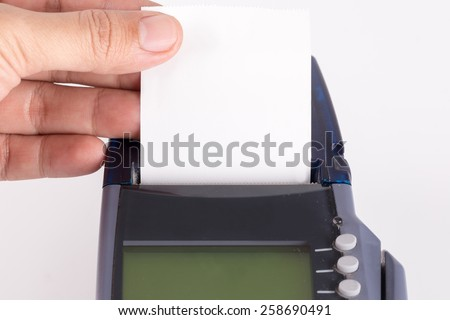Hand With Transaction Paper on Credit Card Machine - stock photo