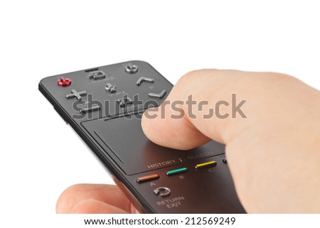 Hand with tv remote control isolated on white background - stock photo