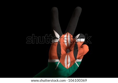 Hand with two finger up gesture in colored kenya national flag as