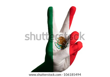 Hand with two finger up gesture in colored mexico national flag as symbol of winning,  - for tourism and touristic advertising, positive political, cultural, social management of country