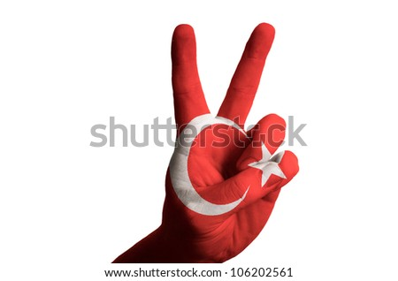 Hand with two finger up gesture in colored turkey national flag as symbol of winning,  - for tourism and touristic advertising, positive political, cultural, social management of country
