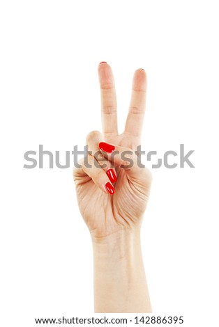 Hand with two fingers up in the peace or victory symbol. Also the sign for the letter V in sign language. Isolated on white background - stock photo