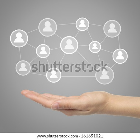 Hand with virtual social media icons - stock photo