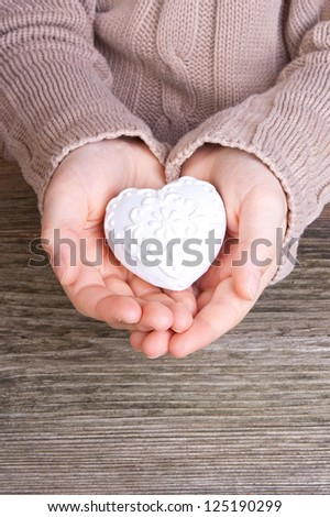 hand with white heart/heart/hand - stock photo