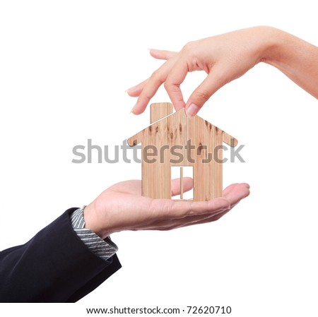hand with wood house and pick up hand - stock photo