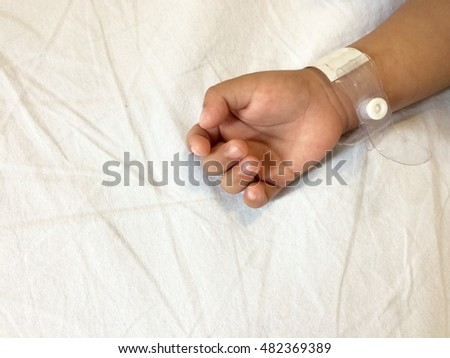 Hand with wrist tag in white background