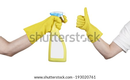 hand with yellow cleaning product glove showing thumb up. Cleaning's done - stock photo