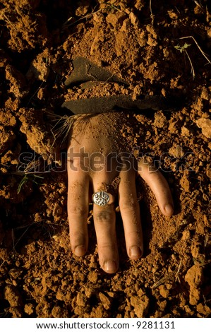 Hand woman buried after his assassination - stock photo