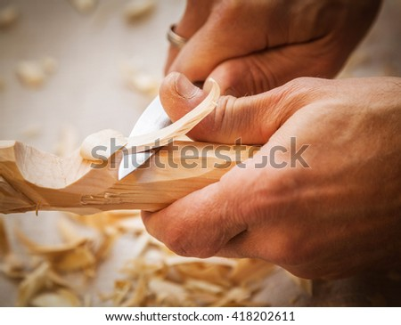 hand woodcarver - stock photo
