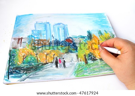Hand working on Dnepropetrovsk city picture on album paper, with oil pastel in hand