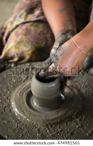 Hand working on pottery wheel,Thailand.