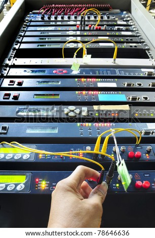 hand working on the communication and internet network server - stock photo