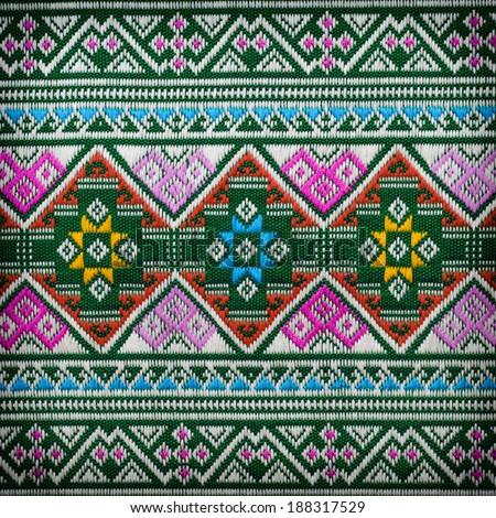 Hand-woven fabrics in Thai-pattern designs - stock photo