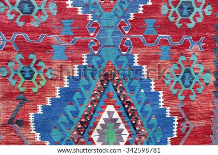 Hand woven kilim pattern, close up view - stock photo