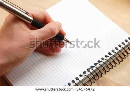 hand write a message on empty notebook