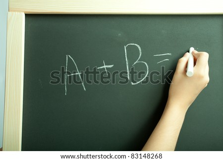 Hand write exercise on the black board - stock photo