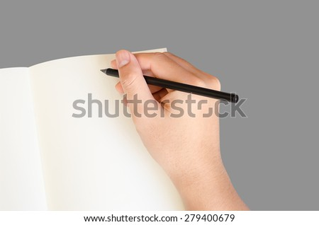 Hand write on notebook on gray background with clipping path - stock photo