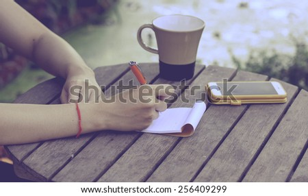 Hand write on notebook on nature background ,vintage - stock photo