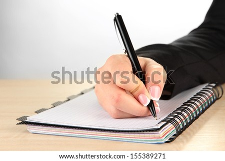 Hand write on notebook, on white background - stock photo
