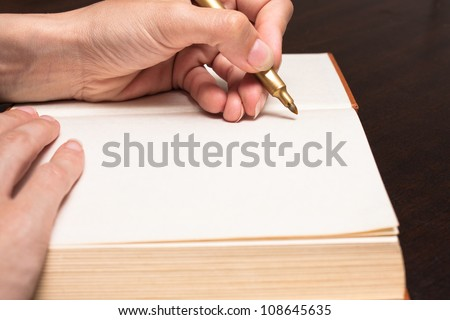 Hand write on open book
