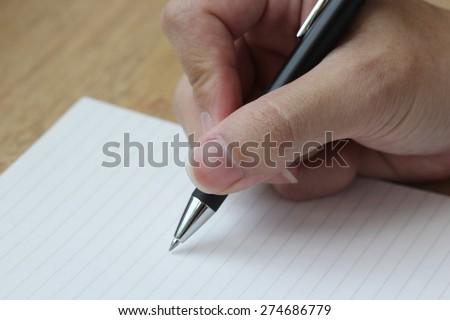 hand write on paper, dark - stock photo