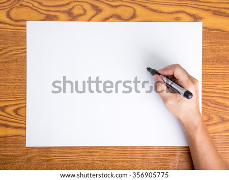 Hand write on the blank paper - stock photo