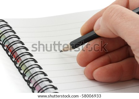 Hand writes a pen on an empty paper - stock photo