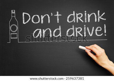 "Hand writes ""Don't drink and drive!"" on blackboard - stock photo"