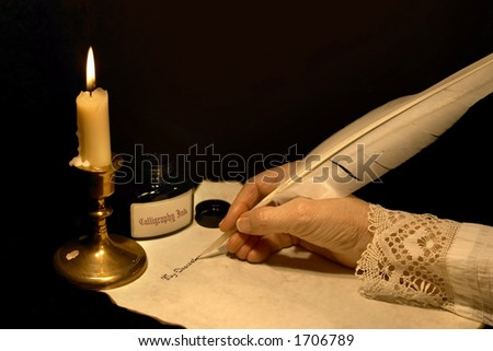 Hand writing a letter with a goose feather - stock photo