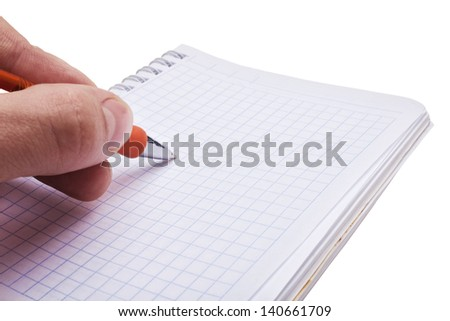 Hand writing a message in the open notebook. Isolated on white background
