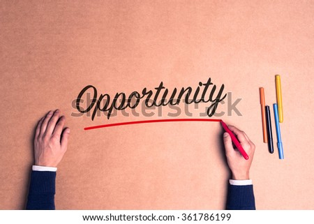 Hand writing a single word Opportunity on paper - stock photo