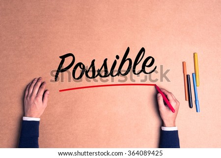 Hand writing a single word Possible on paper - stock photo