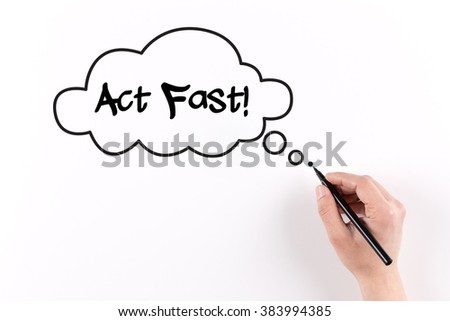 Hand writing Act Fast! on white paper, view from above