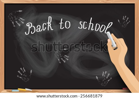 Hand writing at blackboard with chalk inscriptions. - stock photo