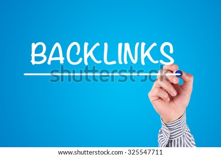 Hand Writing BACKLINKS with Marker on Whiteboard - stock photo