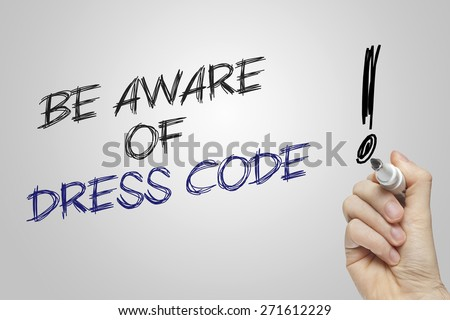 Hand writing be aware of dress code on grey background - stock photo