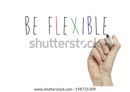 Hand writing be flexible on a white board - stock photo